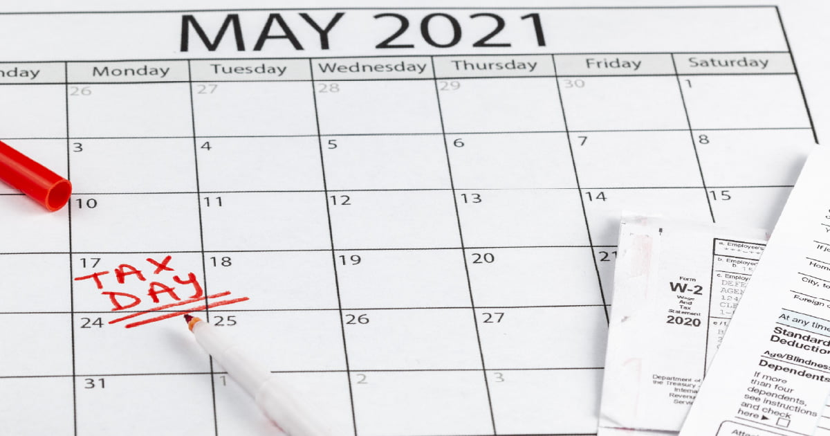 """A May 2021 calendar with the words """"tax day"""" written in bold red on the date of May 17th indicating the tax deadline being delayed until that date."""