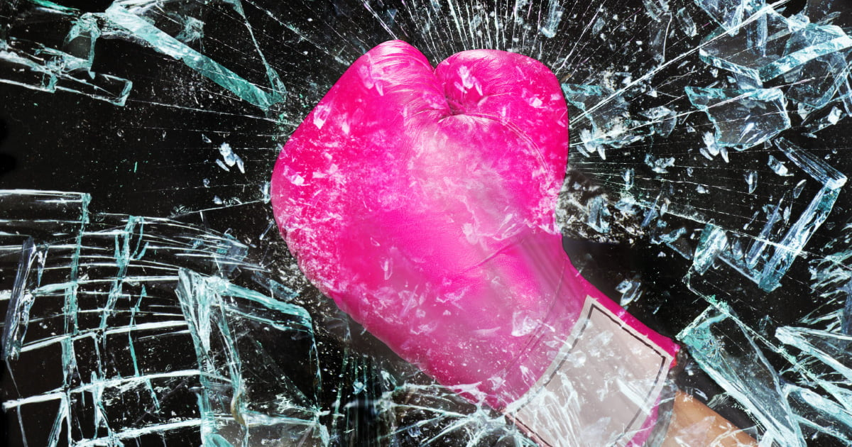 """A pink boxing glove smashing through a """"glass ceiling"""". This is meant to represent women breaking gender barriers and achieving financial independence."""