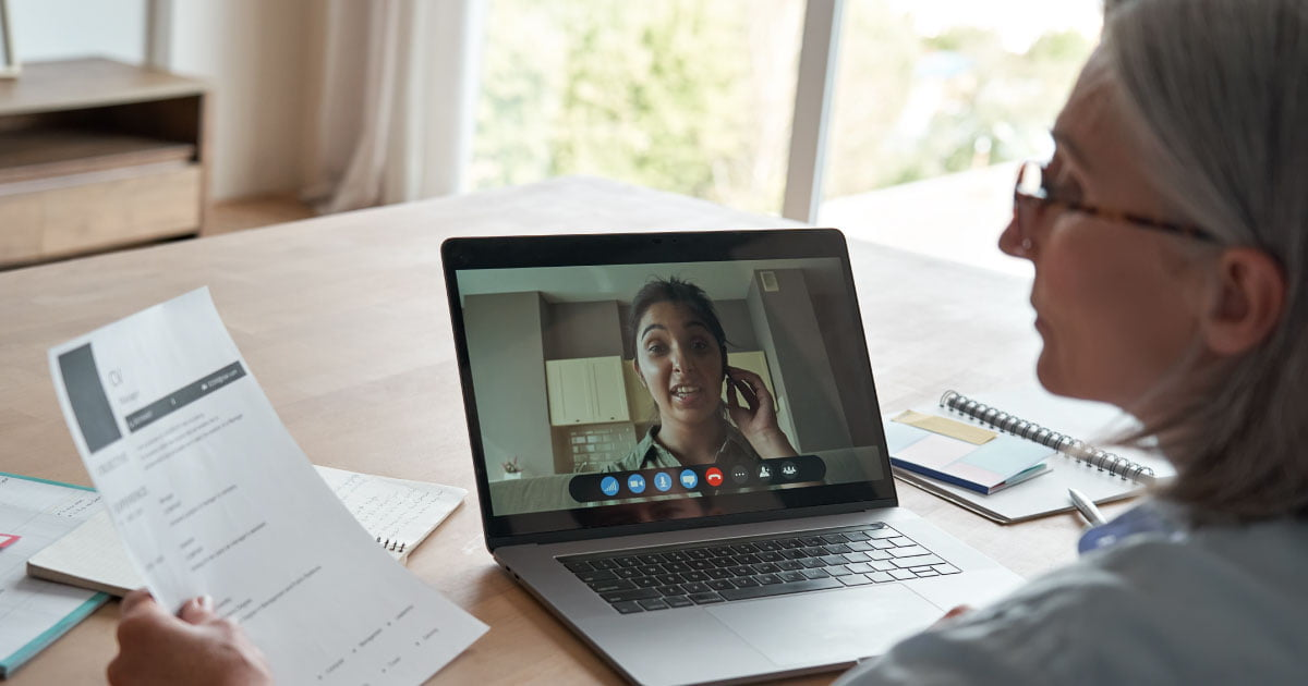 Two women meeting via a virtual web conference to discuss financial planning.