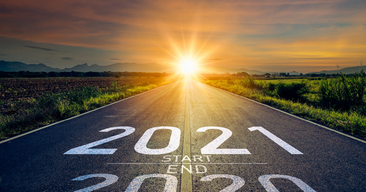 I highway with 2020 and 2021 on it leading into the sunset. This is meant to signify preparing financially for 2021.